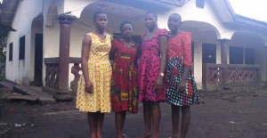Theresia (second from left) with 'her' three girls in Cameroon.